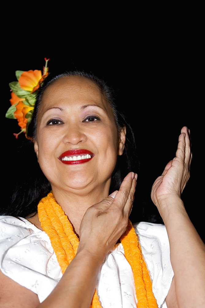 Portrait of a mature woman hula dancing and smiling