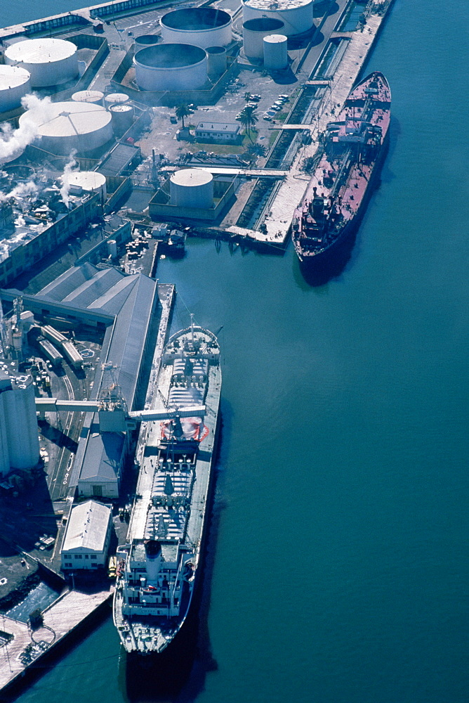 Aerial shot of ships at an oil refinery