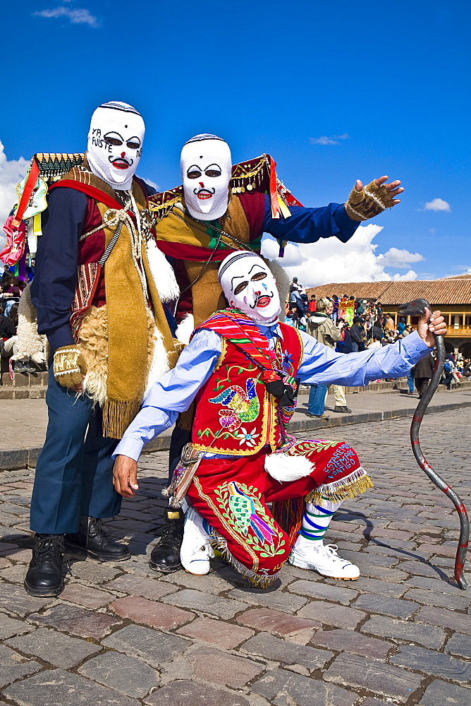 Three people wearing traditional costumes in a festival, Peru - 788-14708
