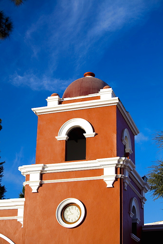 Low angle view of a clock tower, Hotel Mossone, Huacachina, Ica, Ica Region, Peru