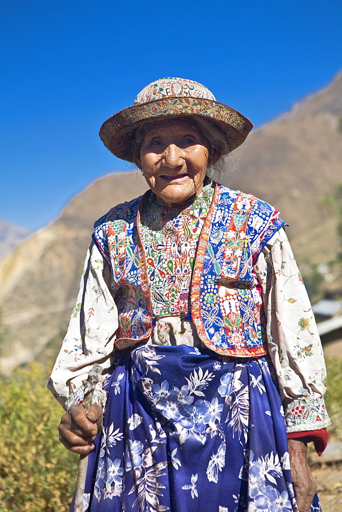 Portrait of a senior woman holding a cane and standing, Coshnirua, Peru