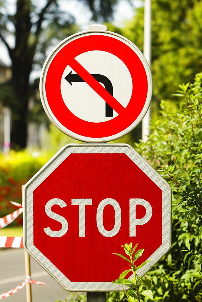 Close-up of stop signboards at the roadside, Le Mans, Sarthe, Pays-de-la-Loire, France