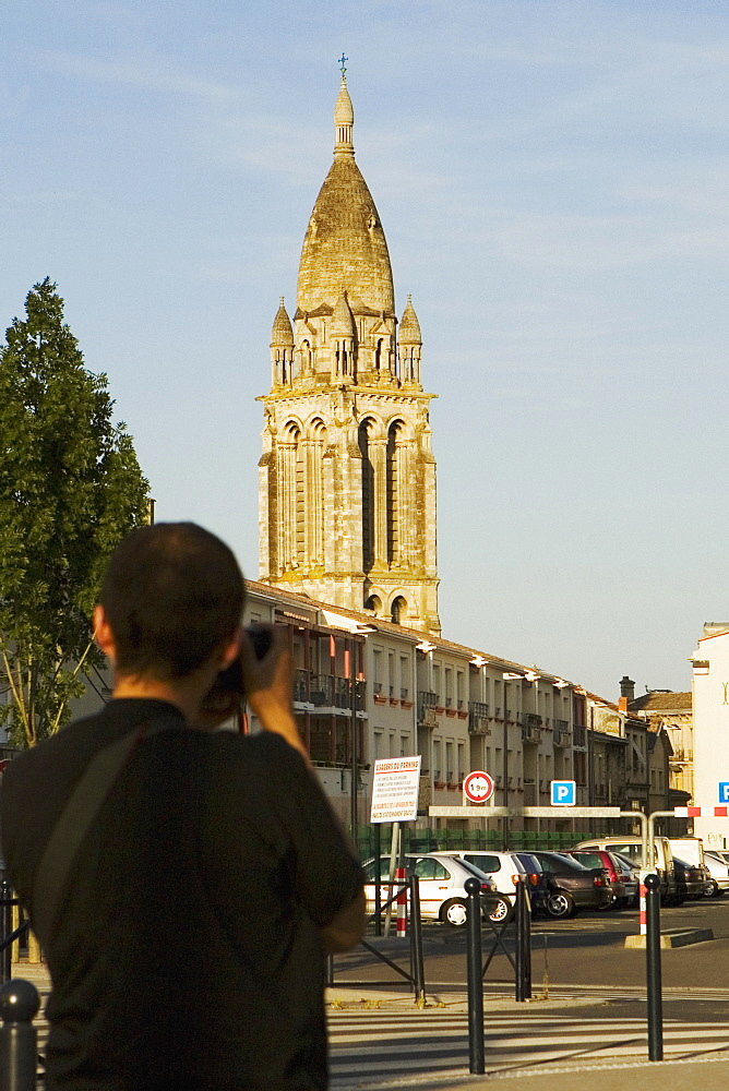 Rear view of a man photographing a church, Leglise Sainte-Marie De La Bastide, Bordeaux, Aquitaine, France