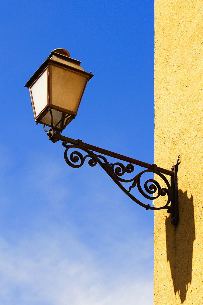 Low angle view of a lantern mounted on the wall, Le Mans, Sarthe, Pays-de-la-Loire, France