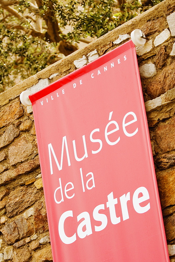 Close-up of a banner hanging on a stone wall, Musee De La Castre, Cote d'Azur, Cannes, Provence-Alpes-Cote D'Azur, France