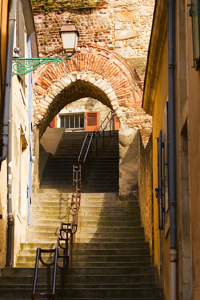 Low angle view of a staircase passing through an archway, Escalier de la Grande Poterne, Le Mans, Sarthe, France