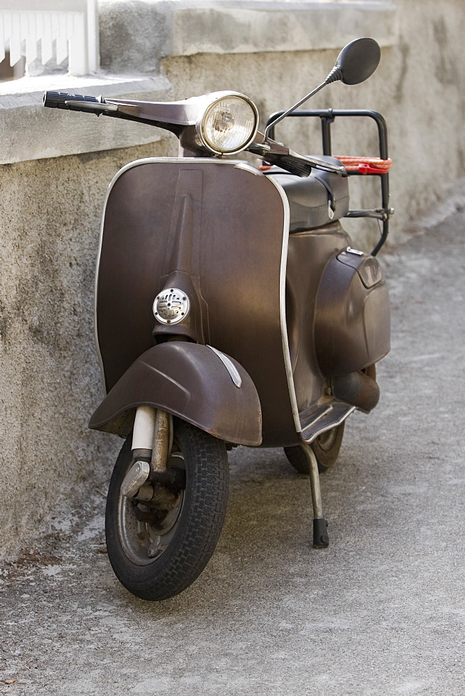 Motor scooter near a wall, Italian Riviera, Santa Margherita Ligure, Genoa, Liguria, Italy