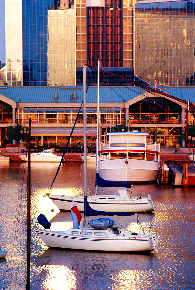 Sunrise of boats in Baltimore inner harbor near harbor place, Maryland