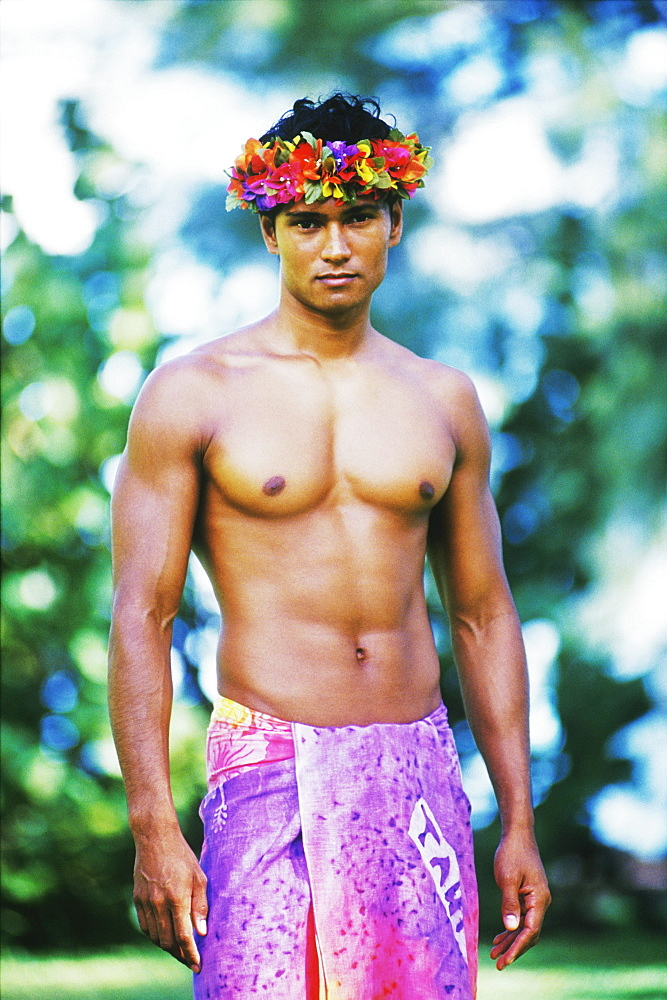 Portrait of a young man wearing a sarong, Hawaii, USA