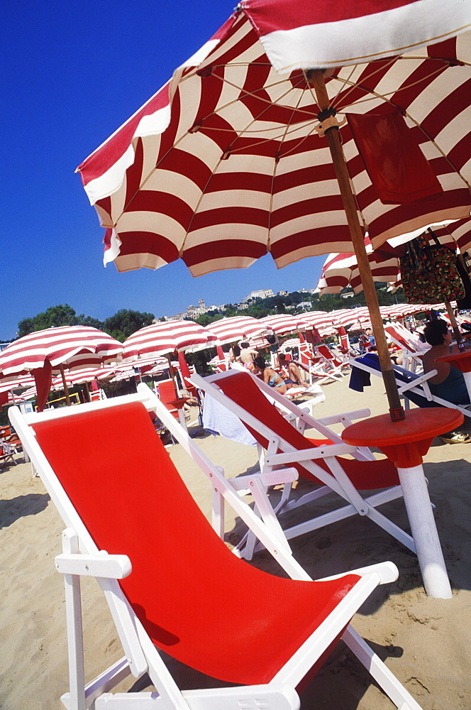 Folding chairs on the beach, Italy