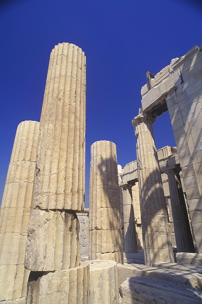Low angle view of columns at an old ruin, Parthenon, Athens, Greece