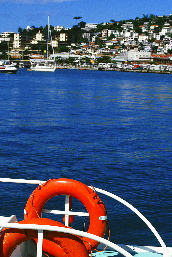 Bright life preservers are seen attached to a railing on a boat in Port de France, Martinique