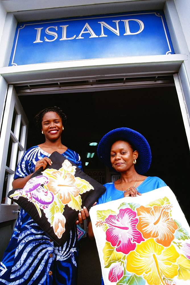Low angle view of two women smiling at the camera, St. Kitts