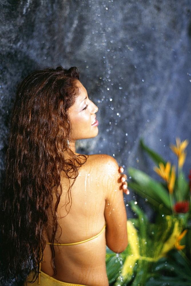 A woman under a shower at Destiny Villa, Jamaica