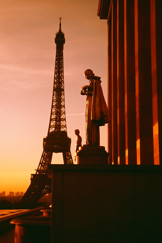Eiffel Tower seen at the back of a palace statue at sunset, Paris, France - 788-3627