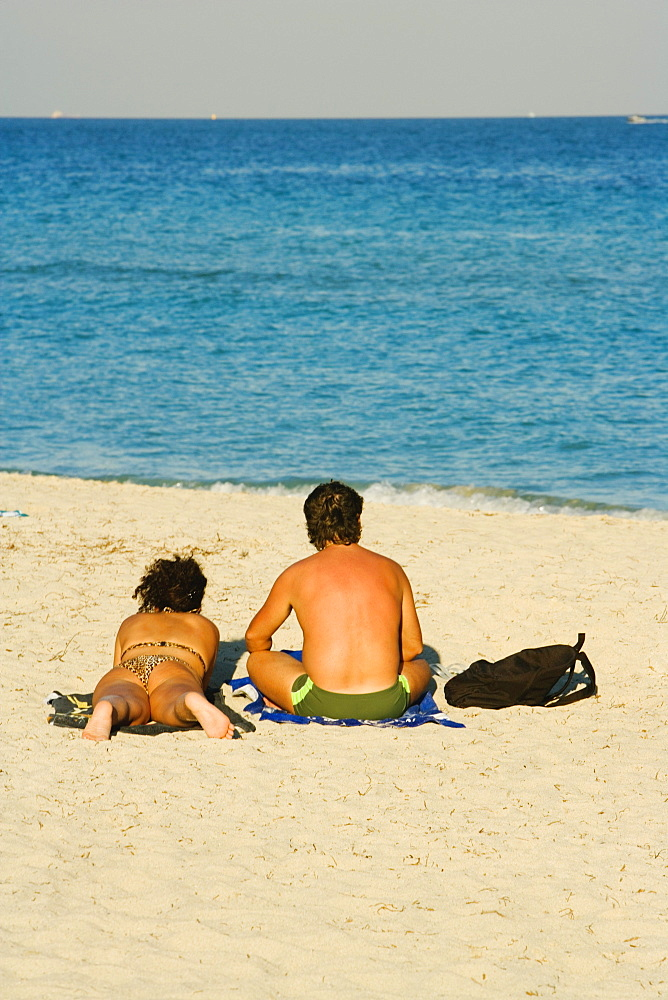 Rear view of a man and woman on the beach