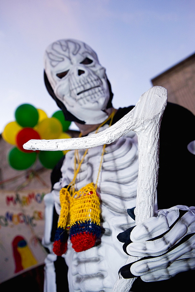 Low angle view of a man wearing a costume and a mask