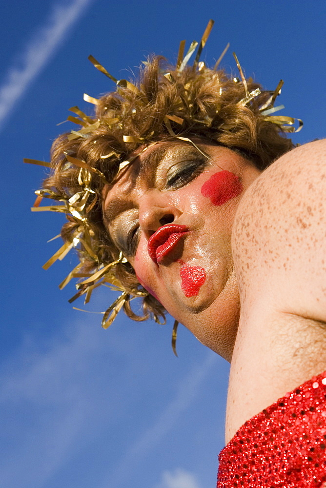 Low angle view of a mature man wearing a costume and puckering his lips