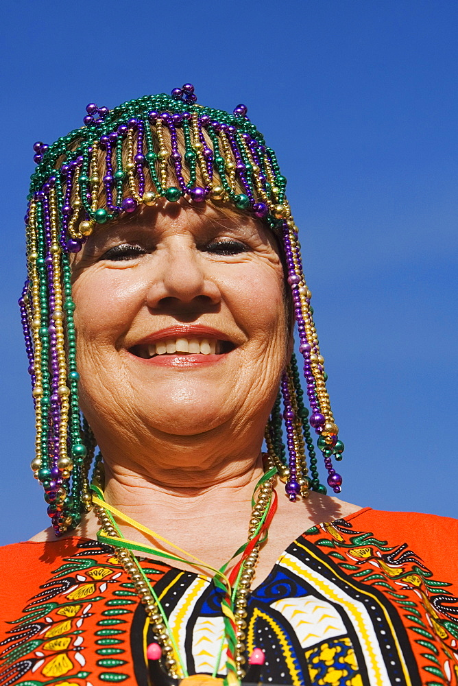 Portrait of a senior woman wearing a beaded headdress and smiling