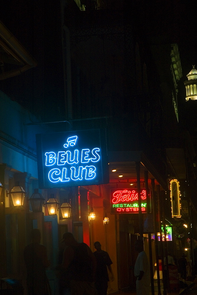 Low angle view of neon signs lit up at night, New Orleans, Louisiana, USA