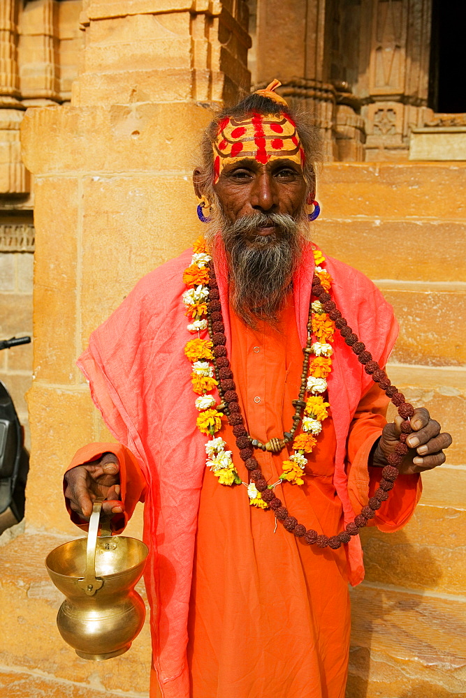 Portrait of a sadhu holding a vase, Jaisalmer, Rajasthan, India