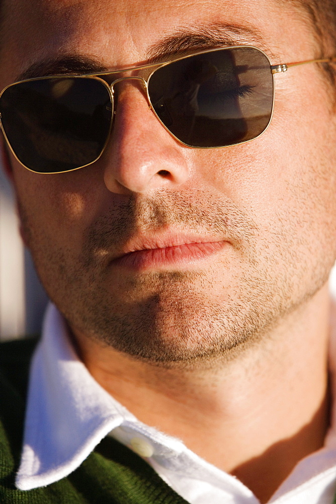 e2838160850a Close-up of a mid adult man wearing sunglasses