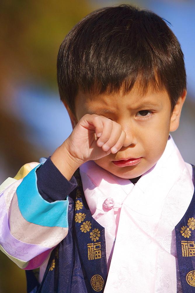 Portrait of a boy crying
