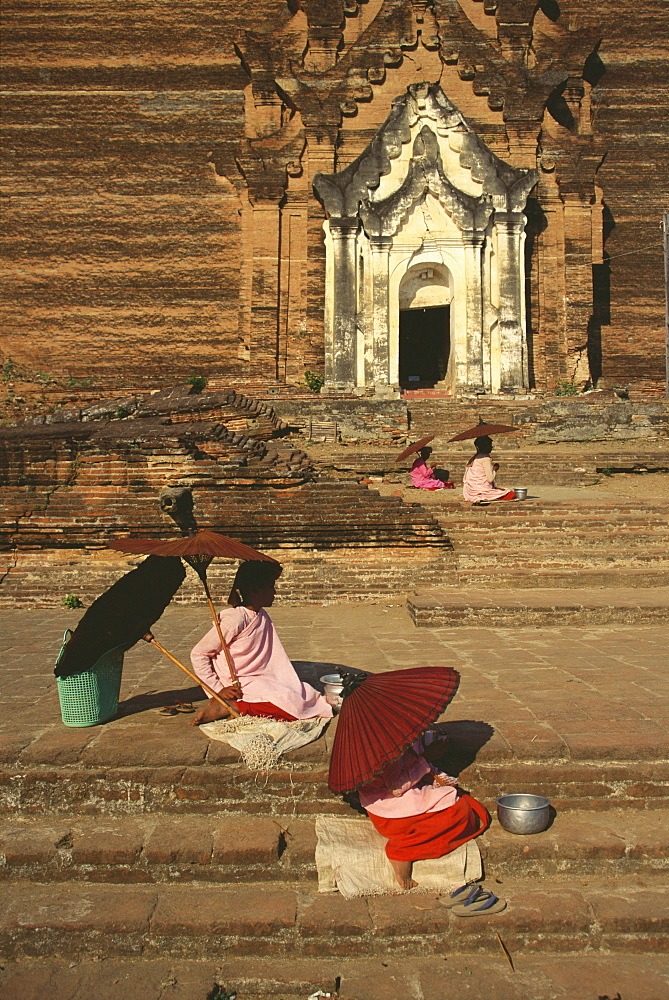High angle view of beggars begging in front of a temple, Mingun, Sagaing Divison, Myanmar