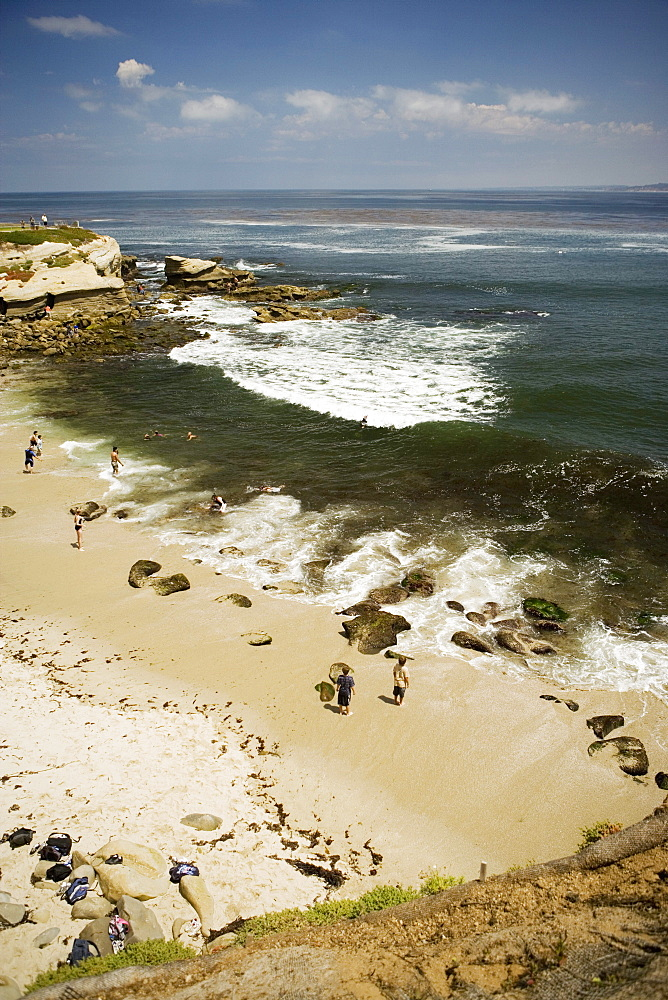 High angle view of people on the beach, La Jolla Reefs, San Diego, California, USA