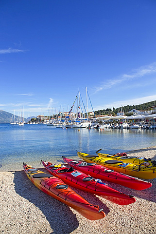 Greece, Kefalonia, Fiskardo, Kayaks in a row, on sunny beach