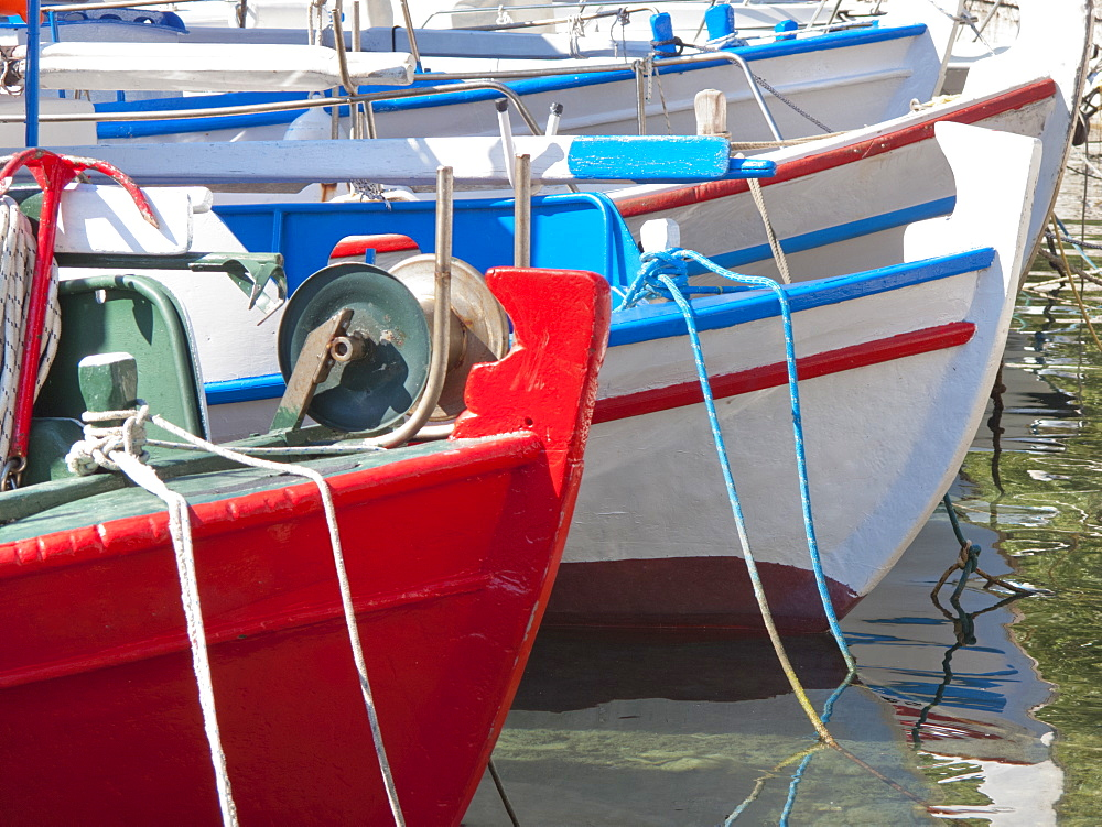 Greece, Kefalonia, Brightly coloured boats moored in harbour