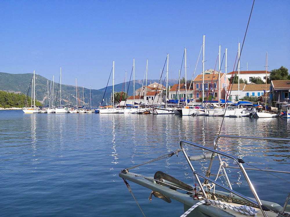 Greece, Kefalonia, Fiskardo, view of sunny harbour from boat