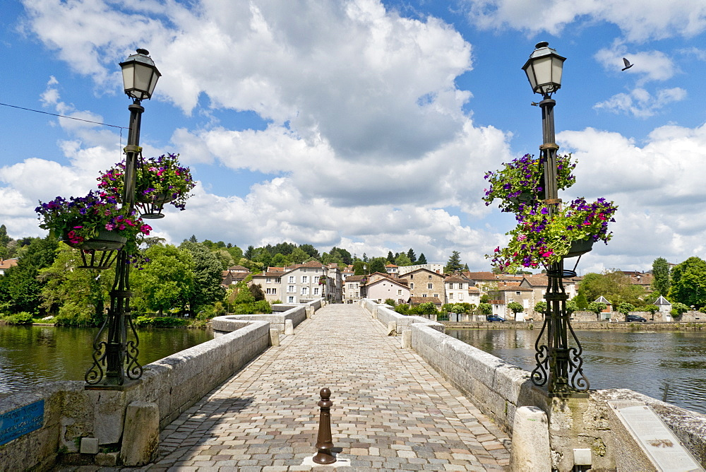 Stone footbridge over river in sunny Confolens, Charente, France