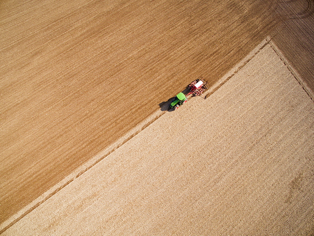Aerial View Of Tractor Pulling Drill Sowing Seed In Field (Drone) - 786-10208