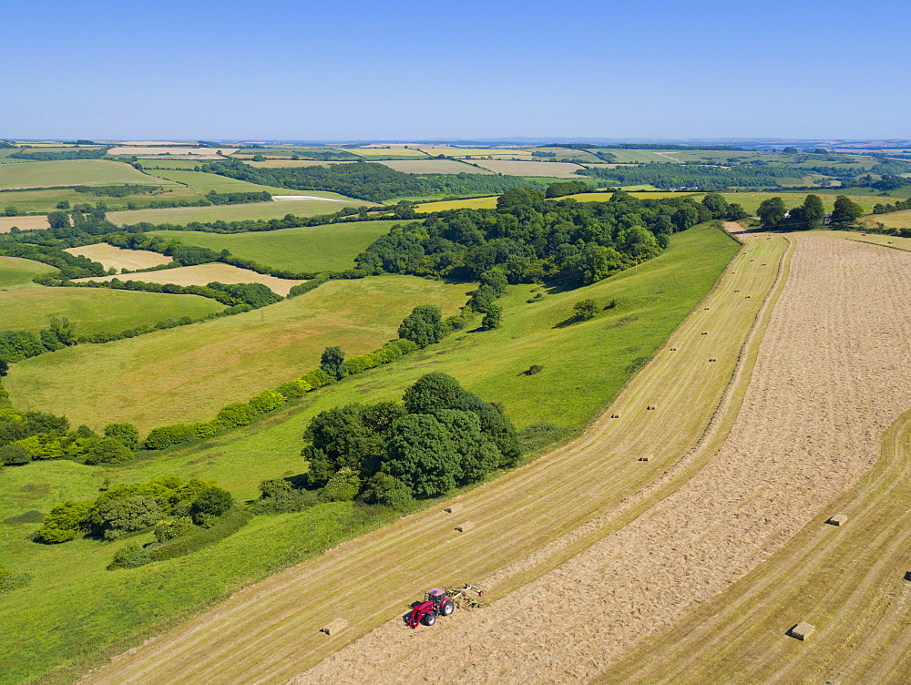 Aerial View Of Tractor Baling Hay In Field (Drone) - 786-10227