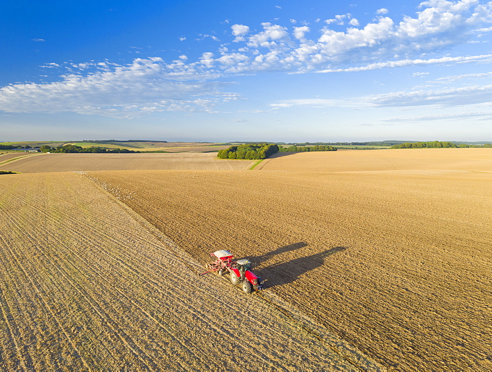 Aerial View Of Tractor Pulling Drill Sowing Seed In Field (Drone) - 786-10233