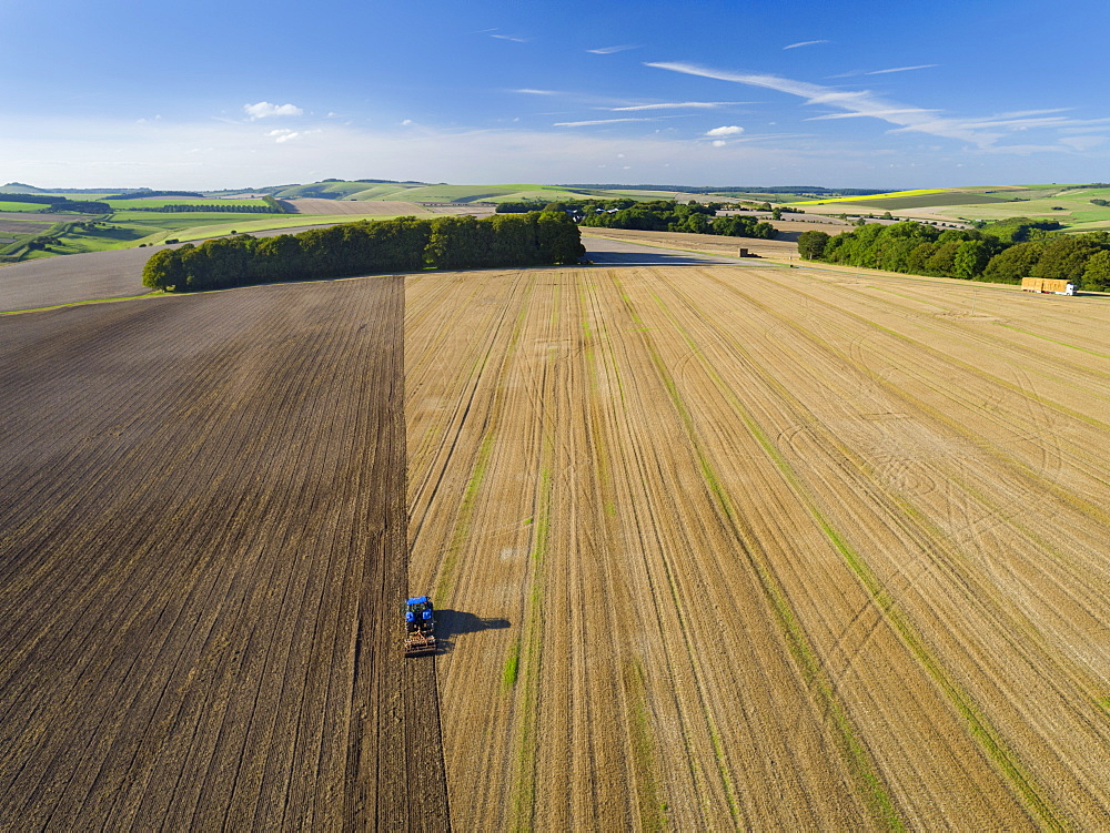 Aerial View Of Tractor Ploughing In Farm Field