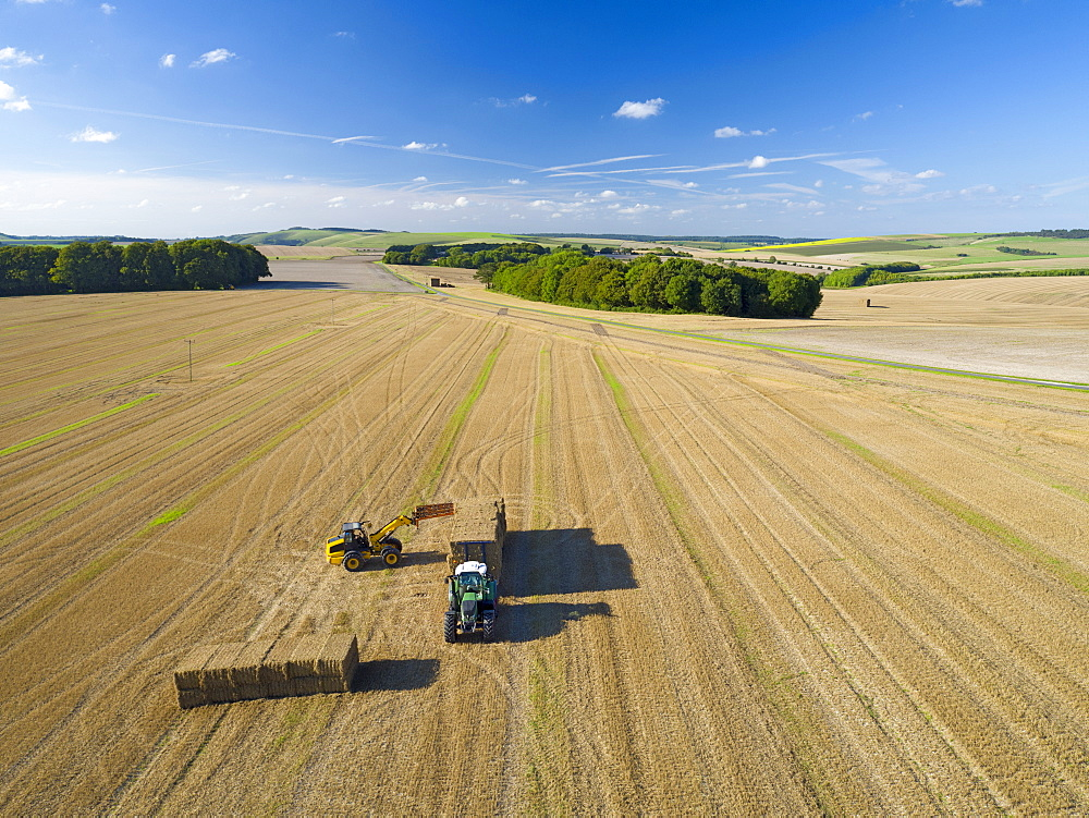 Aerial View Of Loading Bales Onto Trailer After Harvest - 786-10251