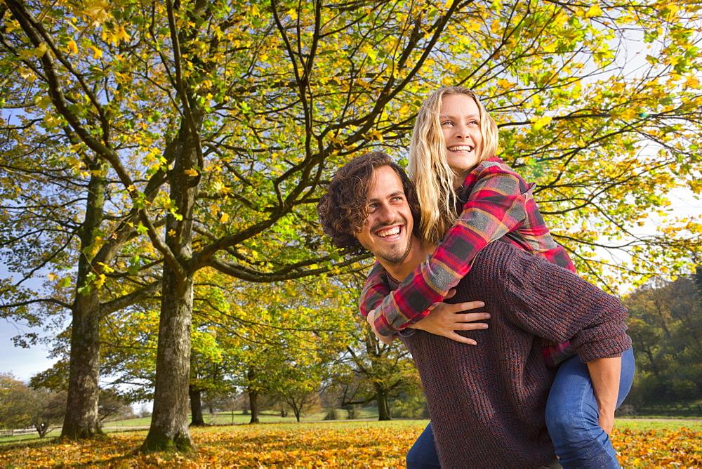 Romantic Couple On Walk Through Autumn Woodland