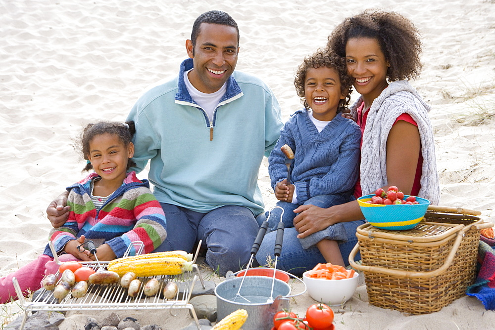 Portrait of family preparing barbecue on beach
