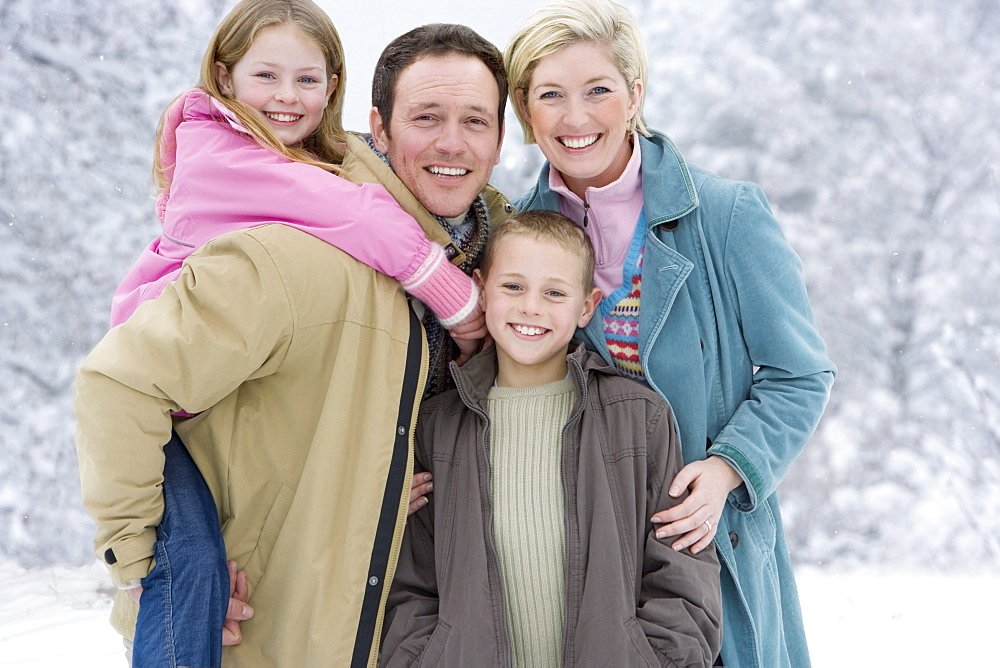 Portrait of young family in winter setting