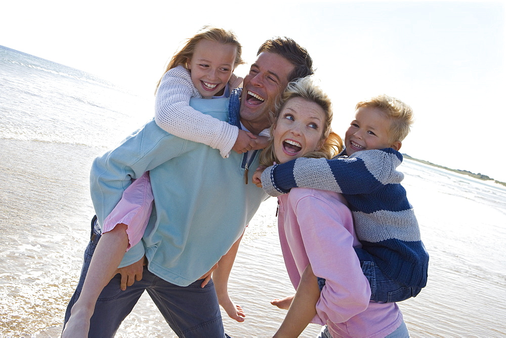 Young happy family at beach