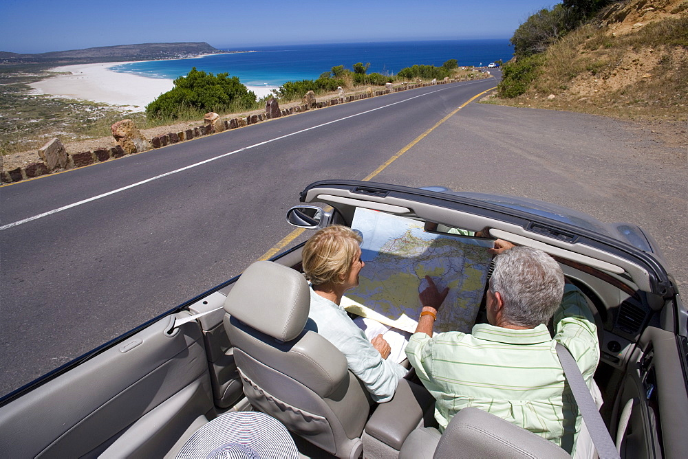 Mature couple looking at map in car - 786-5455
