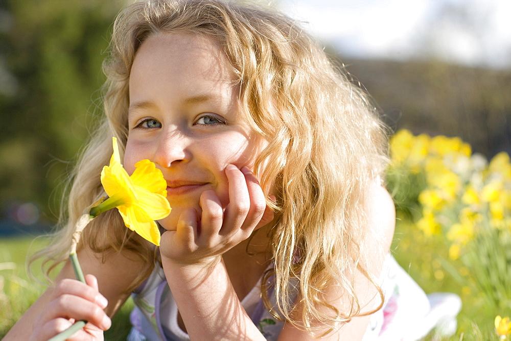 Girl smelling flower