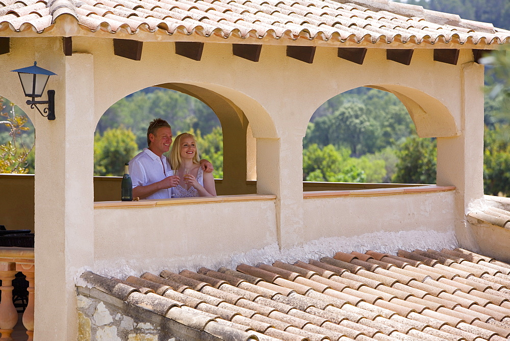 Couple drinking champagne on balcony - 786-5929