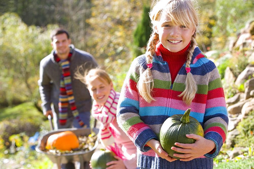 Family gathering autumn pumpkins outdoors