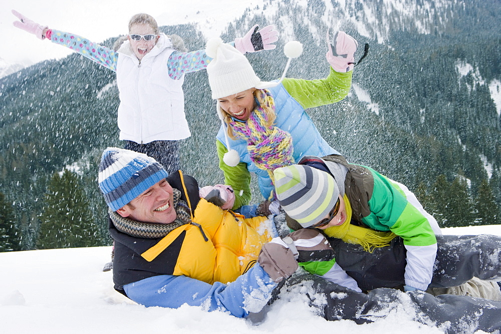 Family having snowball fight in snow - 786-6653