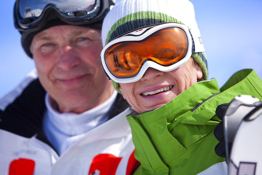 Smiling couple in ski goggles