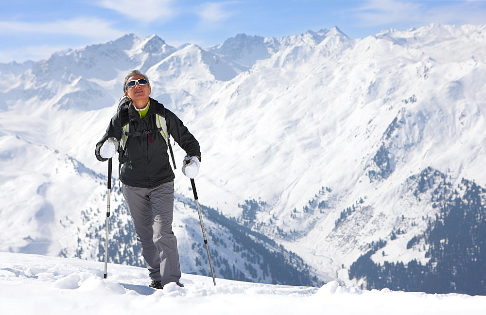 Woman hiking on mountain top in snow