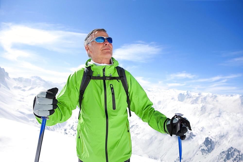 Man hiking on mountain top in snow